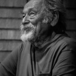 "Jim Harrison reacts to his introduction by Doug Peacock at a benefit reading for the film ""Winter in the Blood"" © John Zumpano"